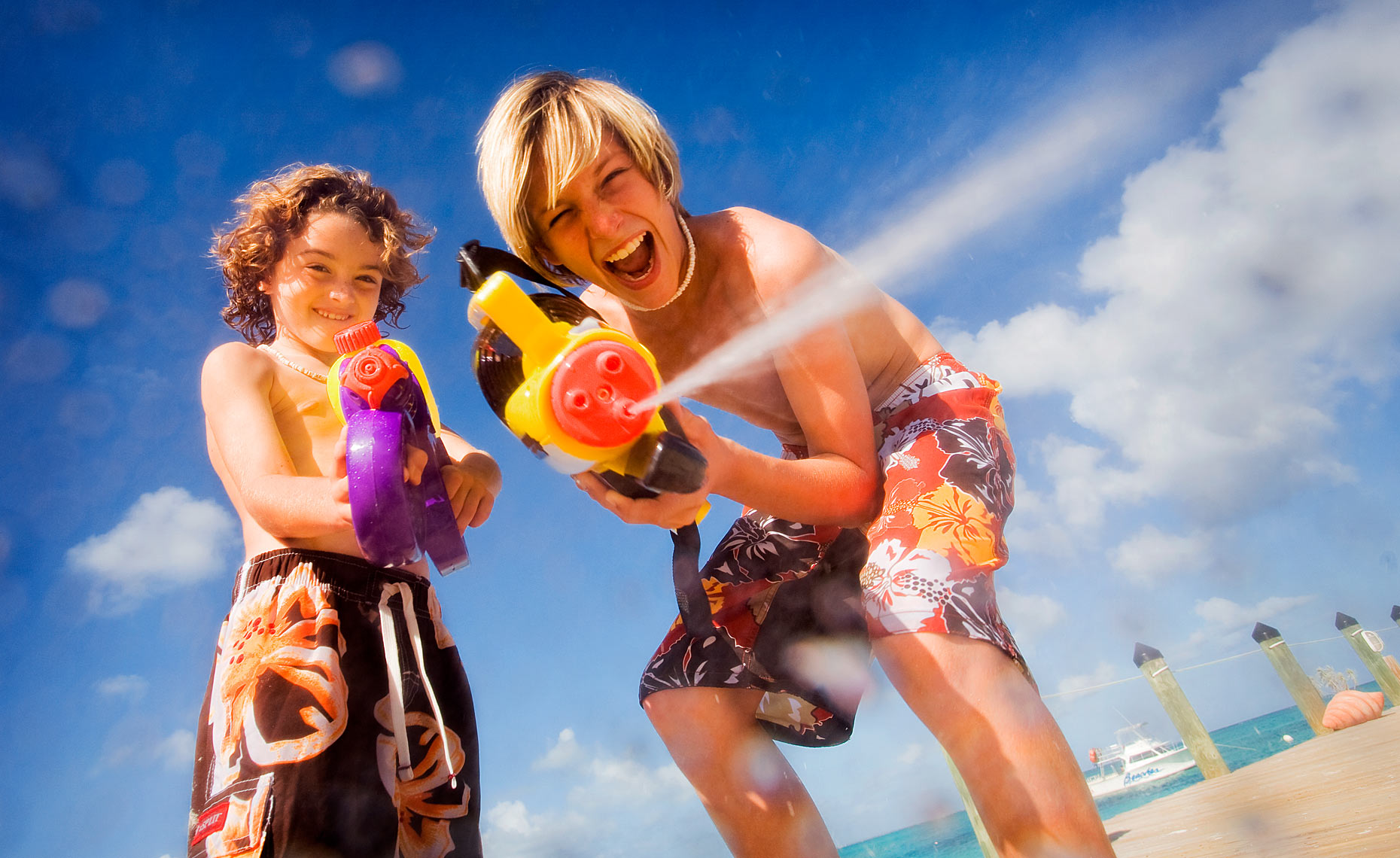 Boys with water guns - Beaches Turks and Caicos.