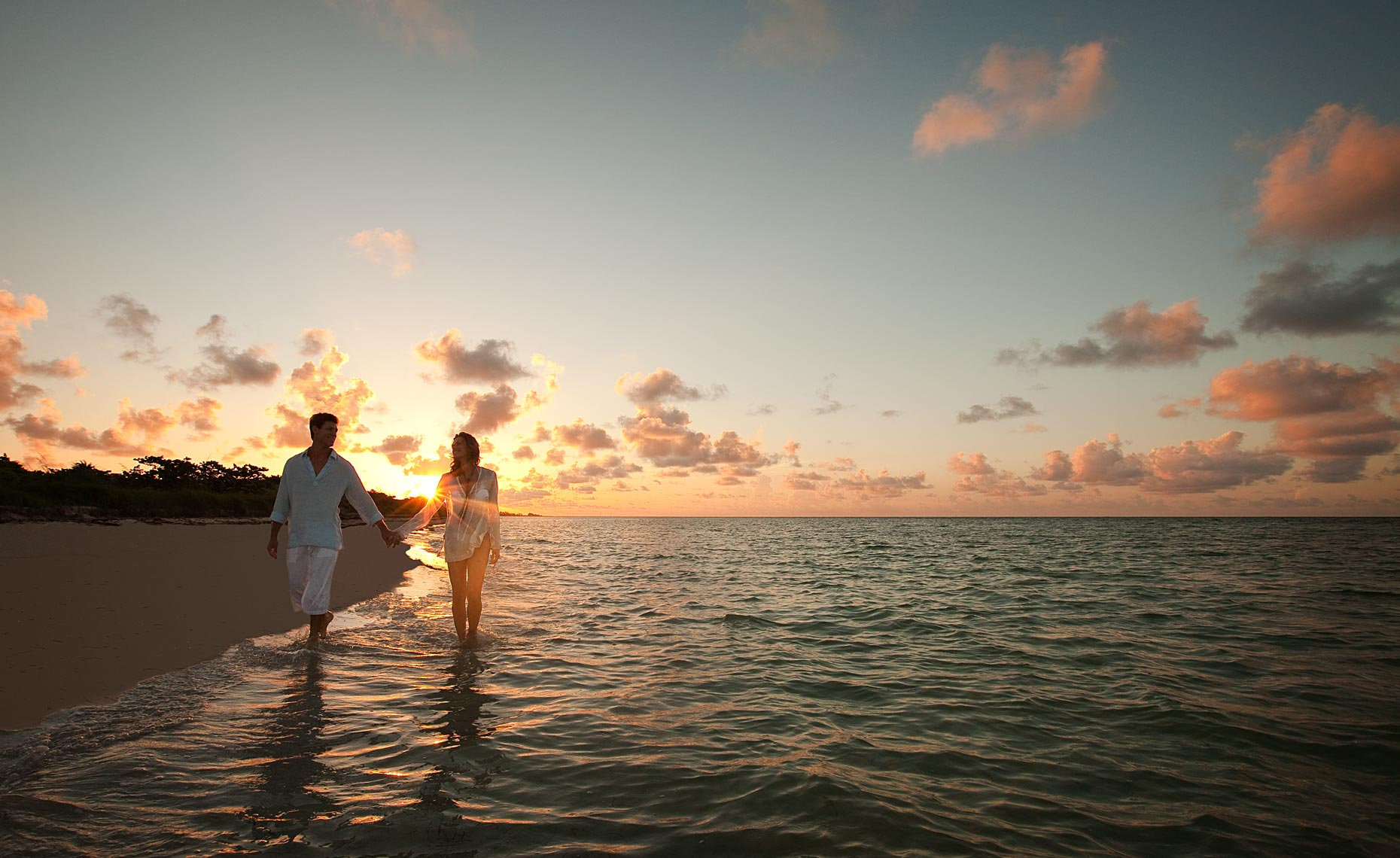 Beach Couple at Sunrise.